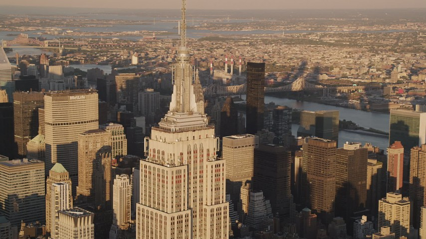 4K stock footage aerial video Flying by the Empire State Building, Midtown Manhattan, New York, sunset Aerial Stock Footage   AX93_044