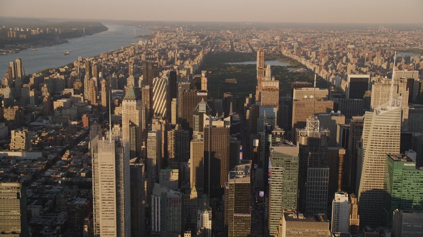5k aerial video Approaching Midtown Manhattan skyscrapers, New York, New York, sunset Aerial Stock Footage | AX93_045