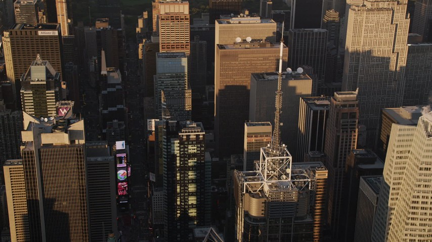 5k aerial video Flying by Times Square, tilt down, Midtown Manhattan, New York, sunset Aerial Stock Footage | AX93_046