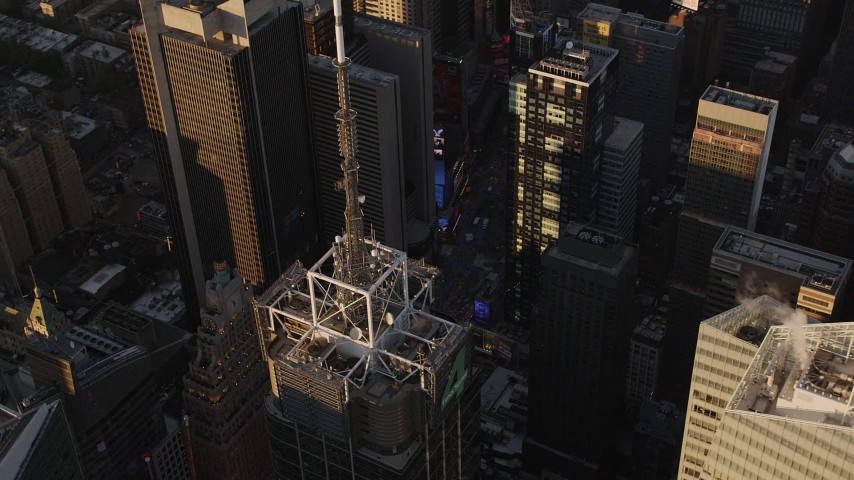 5k aerial video Flying by Times Square, Midtown Manhattan skyscrapers, New York, sunset Aerial Stock Footage | AX93_047