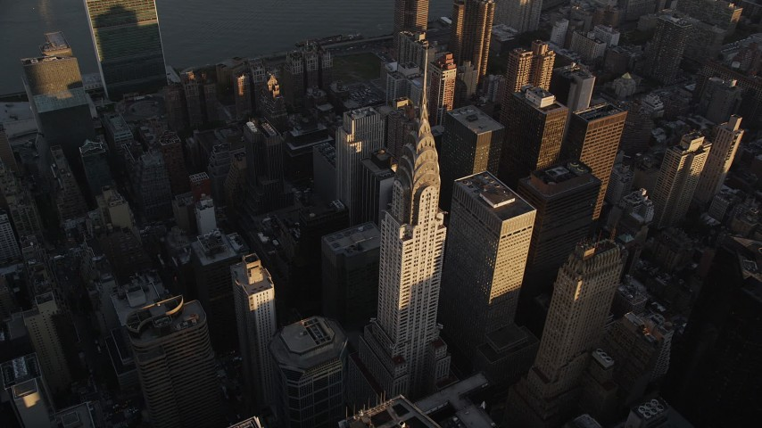 4K stock footage aerial video Flying by the Chrysler Building, Midtown Manhattan, New York, New York, sunset Aerial Stock Footage | AX93_048