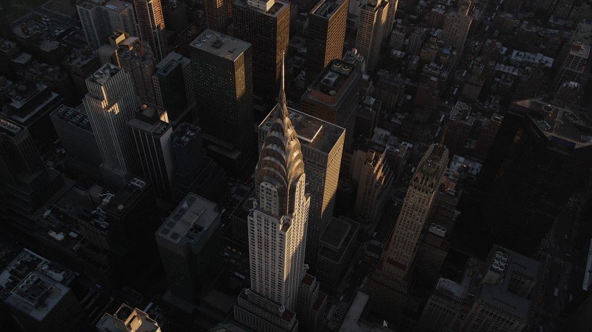 4K stock footage aerial video Flying by the Chrysler Building, Midtown Manhattan, New York, New York, sunset Aerial Stock Footage   AX93_049