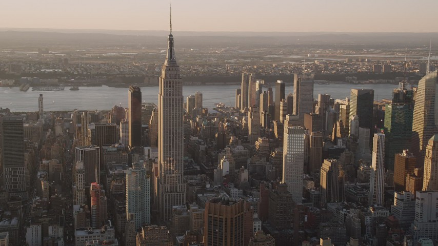 4K stock footage aerial video Flying by the Empire State Building, Midtown Manhattan, New York, sunset Aerial Stock Footage | AX93_053