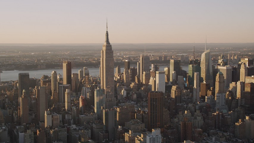 4K stock footage aerial video Flying by the Empire State Building, Midtown Manhattan, New York, sunset Aerial Stock Footage | AX93_054