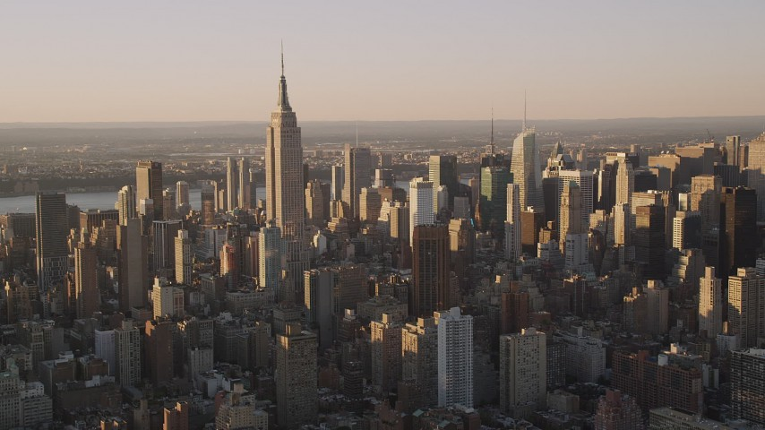 4K stock footage aerial video Flying by the Empire State Building, Midtown Manhattan, New York, sunset Aerial Stock Footage | AX93_055