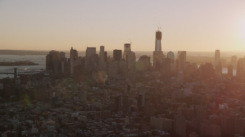 4K stock footage aerial video Flying by Lower Manhattan skyline, seen from Lower East Side, New York, sunset Aerial Stock Footage | AX93_057