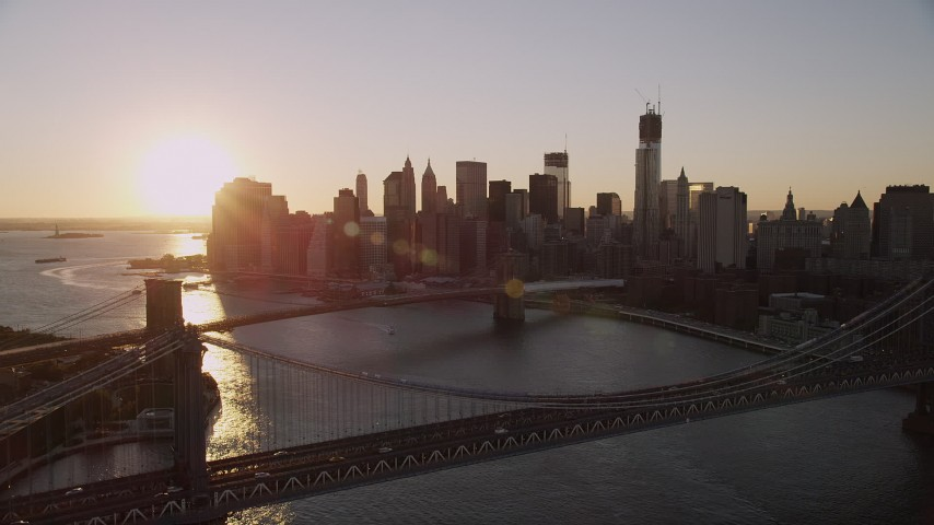 4K stock footage aerial video Manhattan Bridge, approach Brooklyn Bridge, Lower Manhattan, New York, sunset Aerial Stock Footage | AX93_064