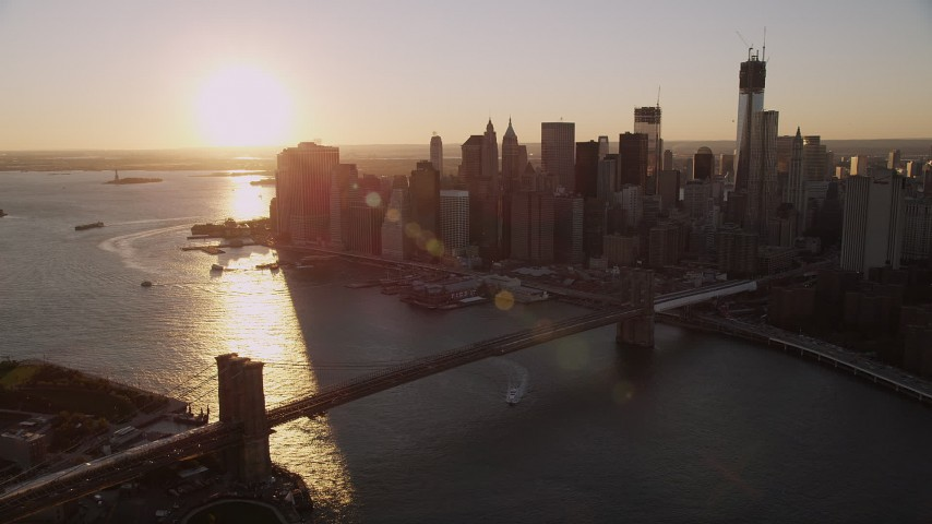 4K stock footage aerial video Approaching Brooklyn Bridge, Lower Manhattan, New York, New York, sunset Aerial Stock Footage | AX93_065