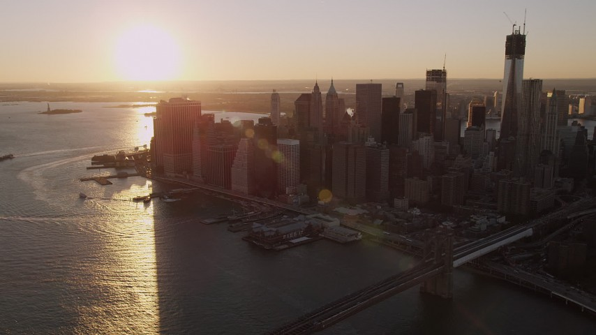 4K stock footage aerial video Approaching Lower Manhattan, East River, New York, New York, sunset Aerial Stock Footage | AX93_066