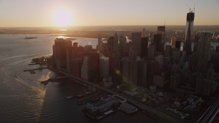 4K stock footage aerial video Approaching Lower Manhattan, East River, New York, New York, sunset Aerial Stock Footage | AX93_067