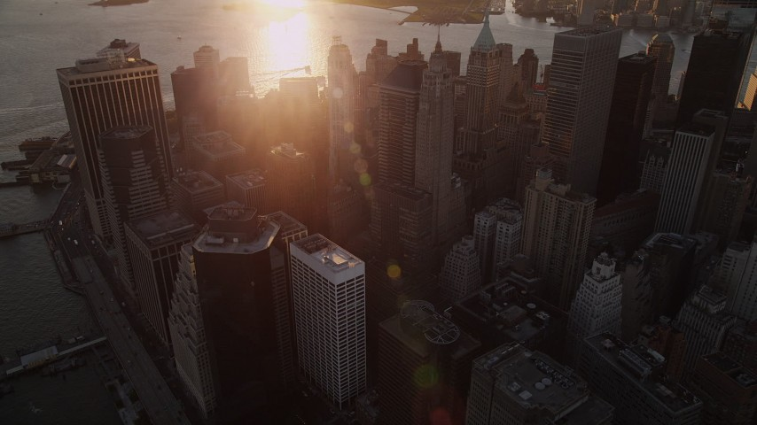 5k aerial video Approaching 70 Pine Street, 60 Wall Street, Lower Manhattan, New York, sunset Aerial Stock Footage | AX93_069