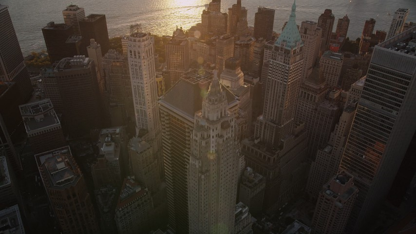4K stock footage aerial video of 70 Pine Street, 40 Wall Street,  60 Wall Street, Lower Manhattan, New York, sunset Aerial Stock Footage | AX93_070