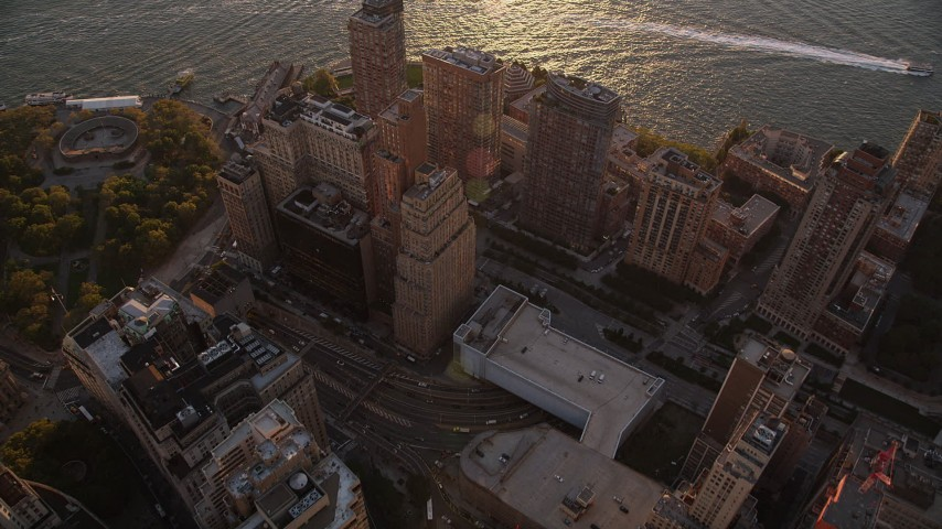 4K stock footage aerial video Approaching skyscrapers, Hudson River, Lower Manhattan, New York, sunset Aerial Stock Footage   AX93_072