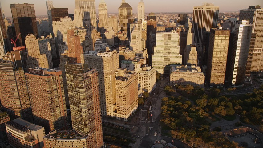 4K stock footage aerial video Flying by skyscrapers near Battery Park, Lower Manhattan, New York, sunset Aerial Stock Footage | AX93_075