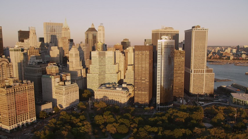 4K stock footage aerial video Flying by skyscrapers near Battery Park, Lower Manhattan, New York, sunset Aerial Stock Footage | AX93_076