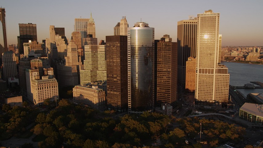 4K stock footage aerial video Flying by skyscrapers near Battery Park, Lower Manhattan, New York, sunset Aerial Stock Footage | AX93_077