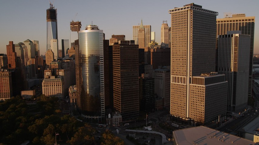 5k aerial video Flying by skyscrapers, East River, Lower Manhattan, New York, New York, sunset Aerial Stock Footage | AX93_078