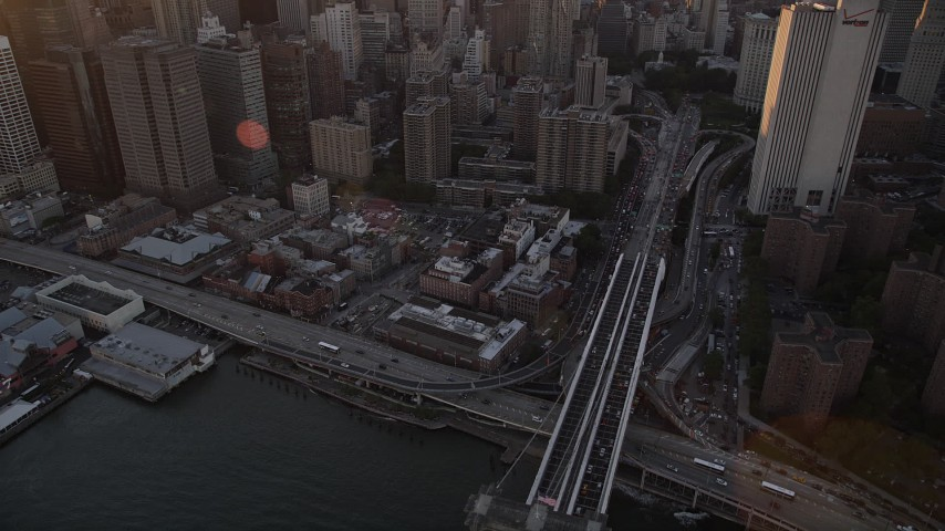 4K stock footage aerial video of Lower Manhattan side of Brooklyn Bridge, reveal skyscrapers, New York, sunset Aerial Stock Footage | AX93_082