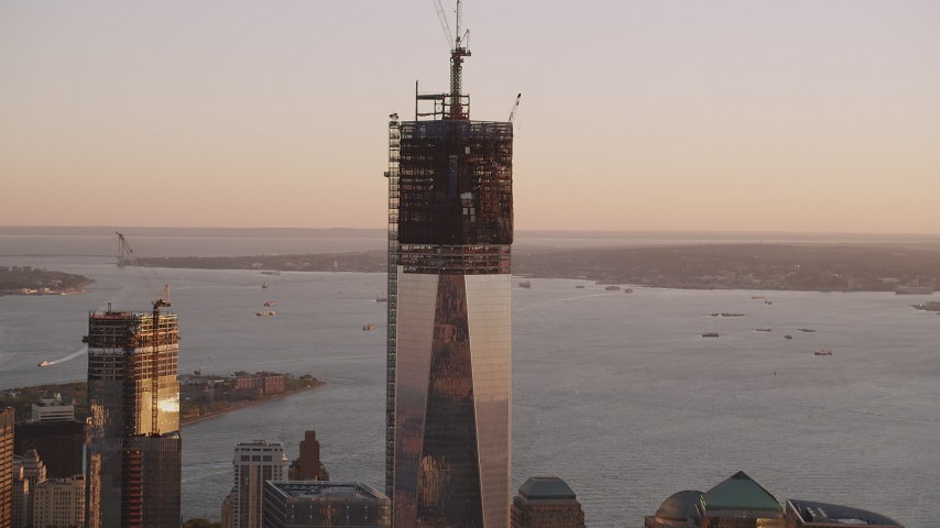 4K stock footage aerial video Flying by Freedom Tower, One World Trade Center, Lower Manhattan, sunset Aerial Stock Footage | AX93_088