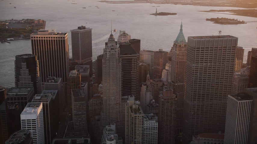 4K stock footage aerial video Flying by 70 Pine Street, Lower Manhattan, New York, New York, sunset Aerial Stock Footage | AX93_092