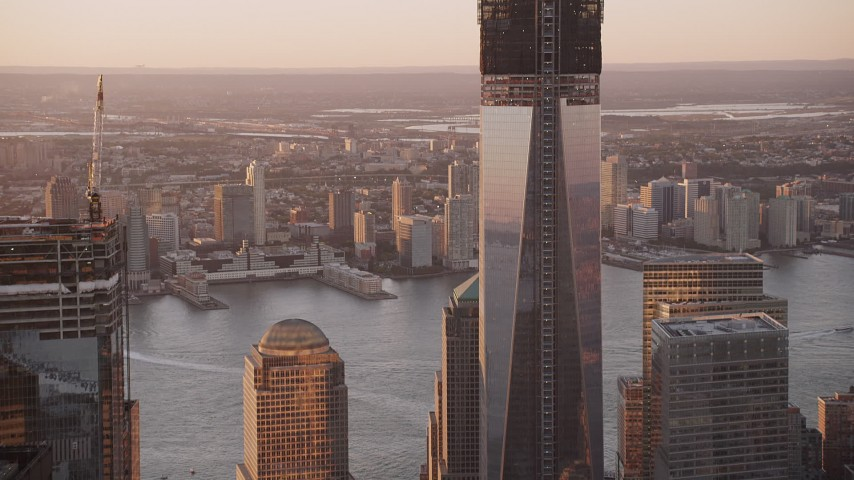 4K aerial video Tilt to the top of One World Trade Center, Lower Manhattan, New York, sunset Aerial Stock Footage | AX93_094