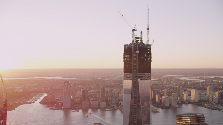 4K stock footage aerial video of One World Trade Center, reveal World Trade Center Memorial, New York, sunset Aerial Stock Footage | AX93_095