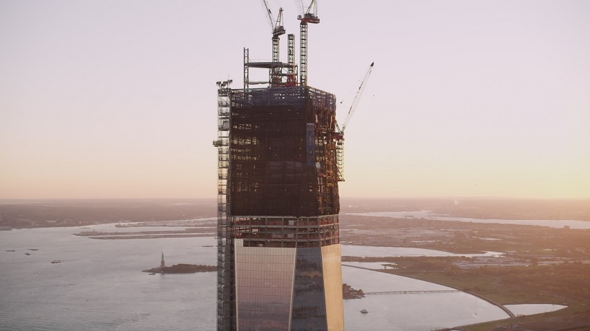 4K stock footage aerial video Flying by the top of One World Trade Center, Lower Manhattan, New York, sunset Aerial Stock Footage | AX93_097