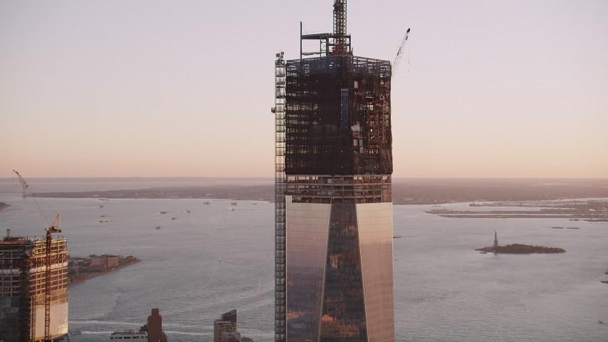 4K stock footage aerial video Tilting down One World Trade Center, Lower Manhattan, New York, New York, sunset Aerial Stock Footage | AX93_098