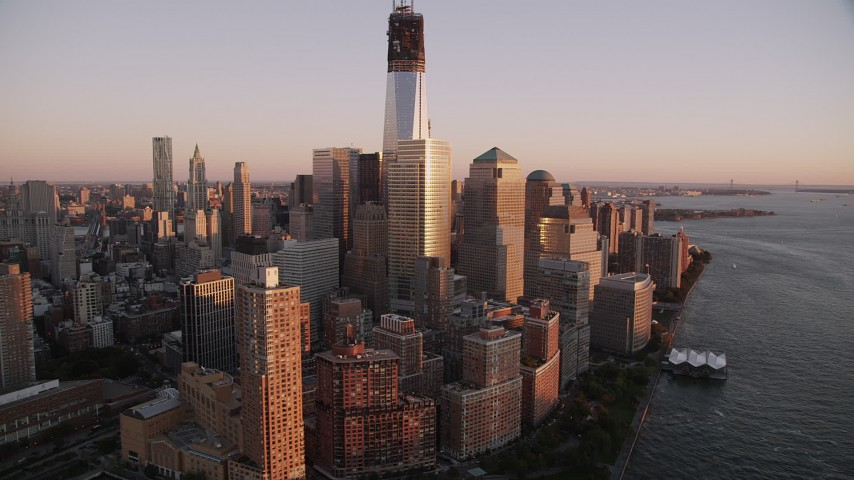 4K stock footage aerial video Flying by World Trade Center, Freedom Tower, Lower Manhattan, New York, sunset Aerial Stock Footage | AX93_100