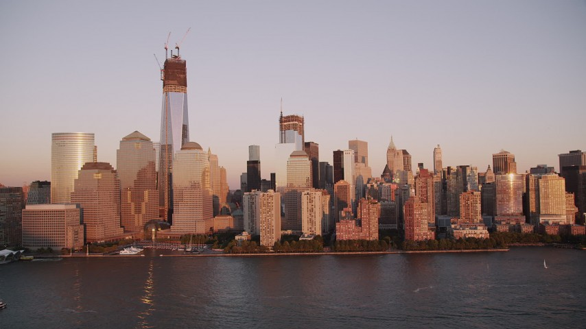 4K stock footage aerial video Flying by Freedom Tower, Lower Manhattan, Hudson River, New York, sunset Aerial Stock Footage   AX93_103
