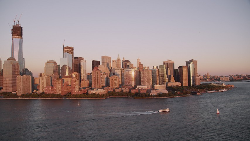 5k aerial video Flying by Lower Manhattan skyline, Hudson River, New York, New York, sunset Aerial Stock Footage | AX93_104