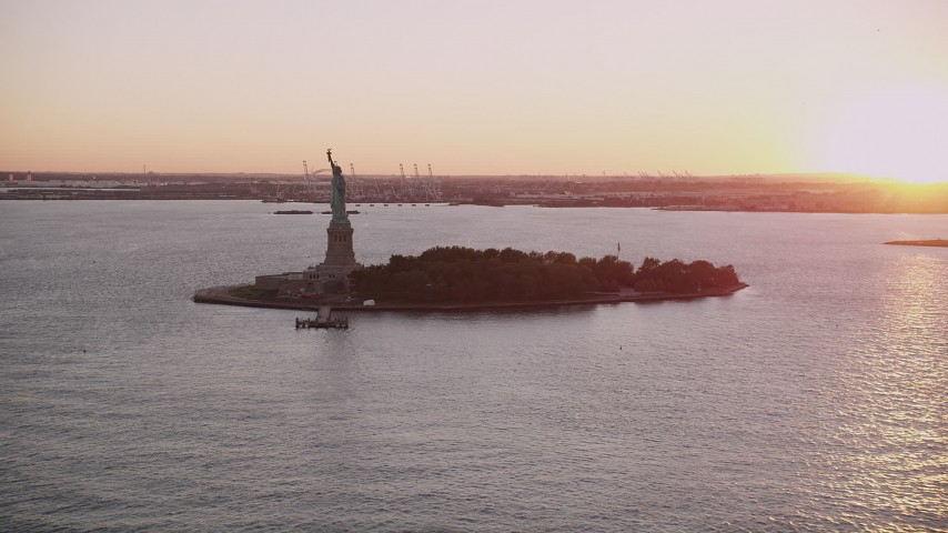 4K stock footage aerial video Approaching the Statue of Liberty, New York, New York, sunset Aerial Stock Footage | AX93_106