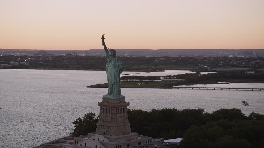 4K stock footage aerial video Flying by the Statue of Liberty, New York, New York, sunset Aerial Stock Footage | AX93_122