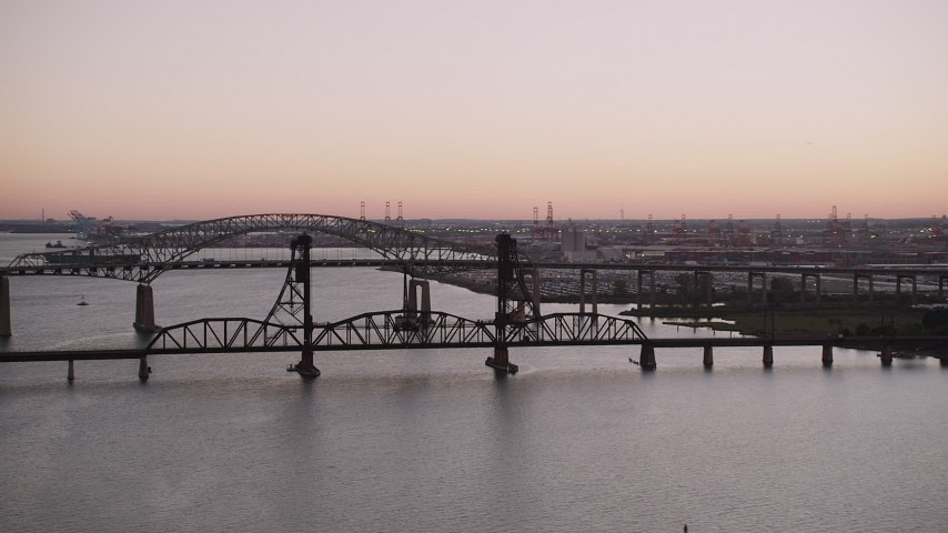 4K stock footage aerial video of Newark Bay Bridge, Lehigh Valley Railroad Bridge, Newark Bay, Newark, New Jersey, twilight Aerial Stock Footage | AX93_128