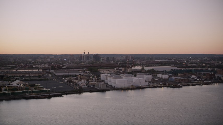 4K stock footage aerial video Flying by an oil refinery, Newark Bay, Newark, New Jersey, twilight Aerial Stock Footage | AX93_129