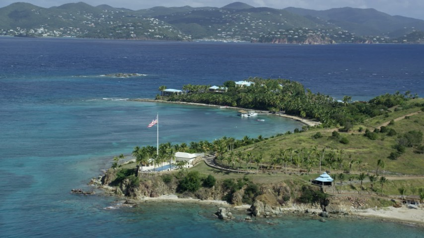 5k stock footage stock footage aerial video orbit American flag and pool area on Little St James Island, St Thomas, Virgin Islands Aerial Stock Footage | AX96_161