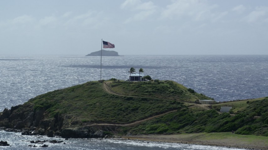 5k stock footage stock footage aerial video American flag and circular building on Little St James Island, St Thomas, Virgin Islands Aerial Stock Footage | AX96_165