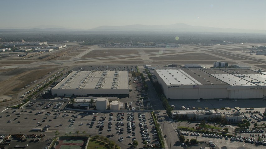 HD stock footage aerial video approach hangars at Long Beach Airport, California Aerial Stock Footage   CAP_003_006