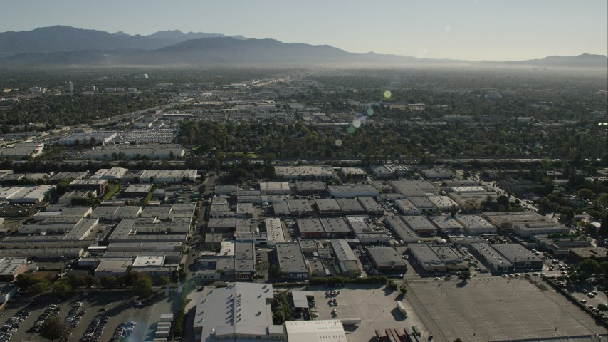 HD stock footage aerial video of flying over warehouse buildings in Van Nuys, California Aerial Stock Footage   CAP_004_002