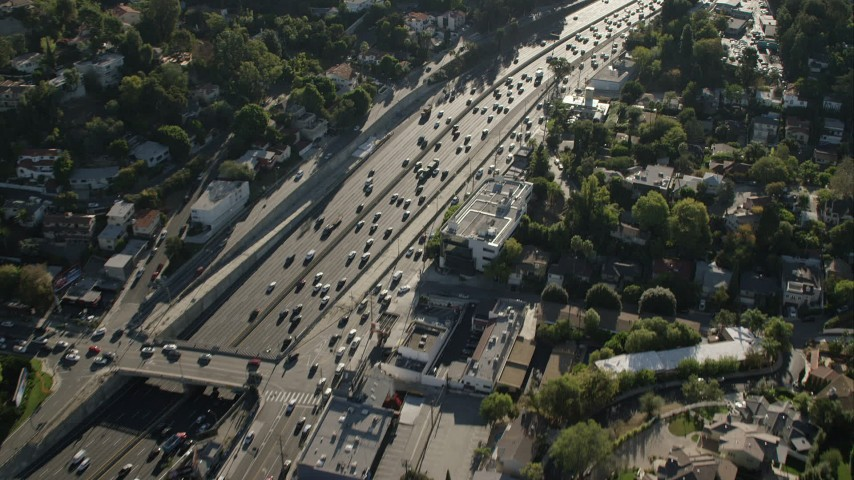 HD stock footage aerial video of a bird's eye view of traffic on the freeway in Universal City, California Aerial Stock Footage | CAP_004_007