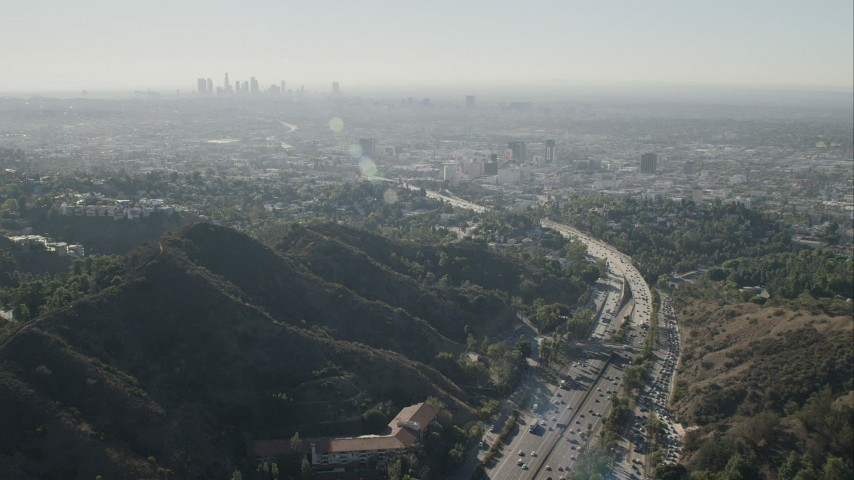 HD stock footage aerial video approach the skyline of Downtown Los Angeles, California from freeway pass Aerial Stock Footage   CAP_004_009