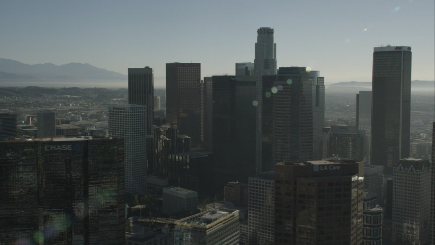 HD stock footage aerial video passing tall skyscrapers in Downtown Los Angeles, California Aerial Stock Footage | CAP_004_016
