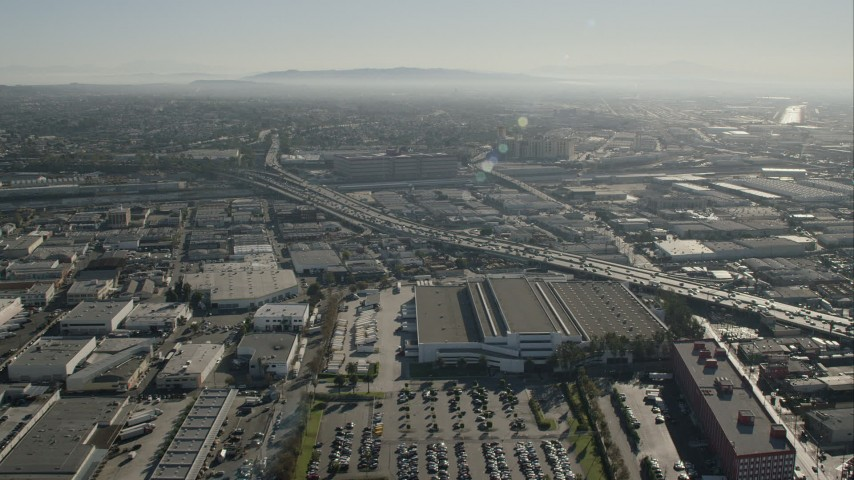 HD stock footage aerial video approach office building beside freeway in Boyle Heights, Los Angeles, California Aerial Stock Footage | CAP_004_019