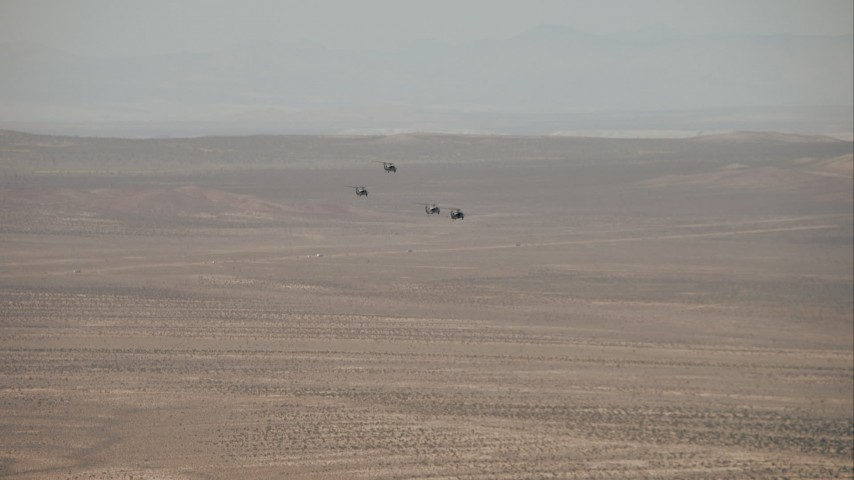HD stock footage aerial video of military helicopters over the Mojave Desert, California Aerial Stock Footage | CAP_005_003