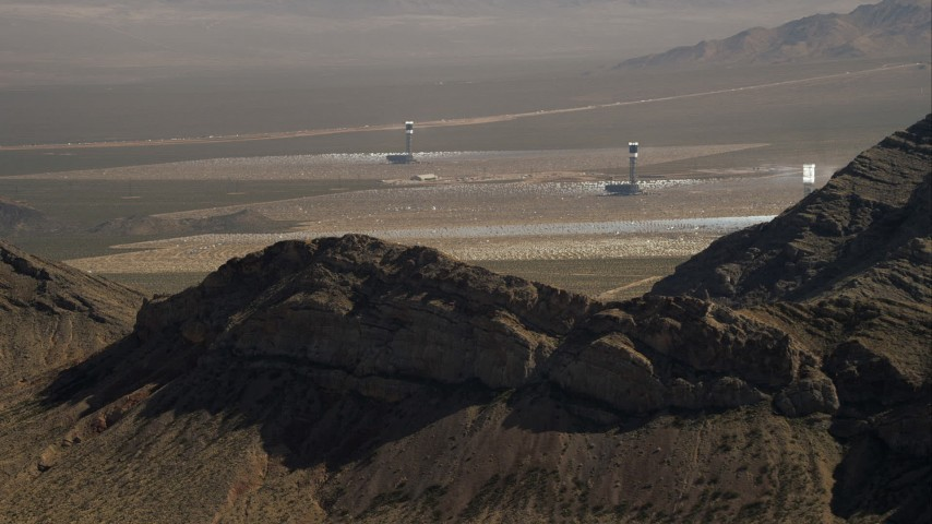 HD stock footage aerial video of solar towers at the Ivanpah Solar Electric Generating System, Mojave Desert, California Aerial Stock Footage | CAP_005_009