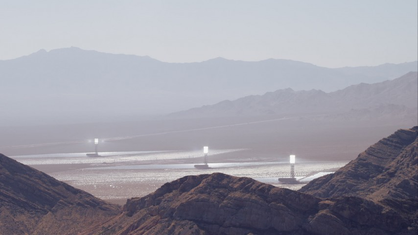 HD stock footage aerial video of solar towers at Ivanpah Solar Electric Generating System seen from mountains, Mojave Desert, California Aerial Stock Footage | CAP_005_016