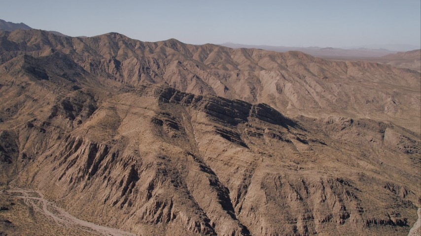HD stock footage aerial video of arid desert mountain ridges, Mojave Desert, California Aerial Stock Footage | CAP_005_018
