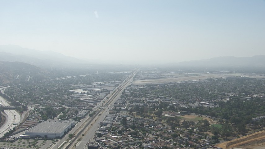 HD aerial  video of neighborhoods and warehouse buildings near Burbank Airport, California Aerial Stock Footage | CAP_006_001
