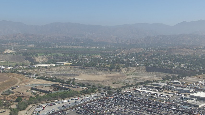 HD stock footage aerial video of approaching a landfill area in Sun Valley, California Aerial Stock Footage | CAP_006_002
