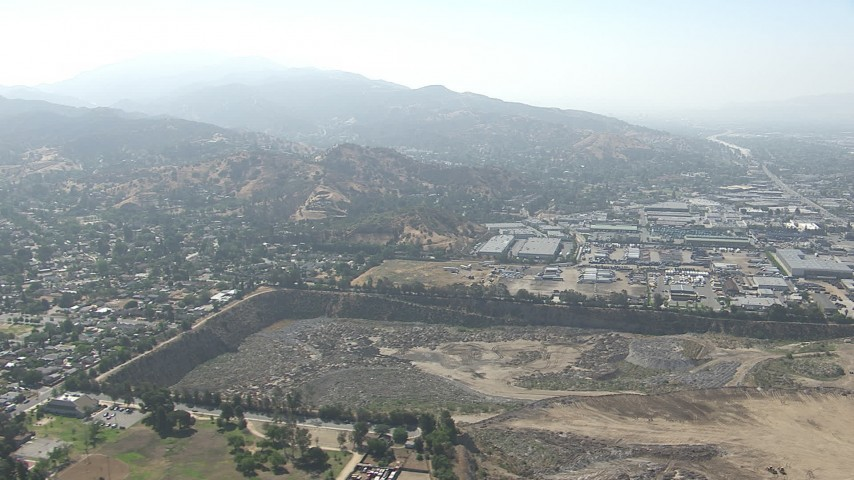 HD stock footage aerial video of warehouse buildings and a large landfill area in Sun Valley, California Aerial Stock Footage | CAP_006_003